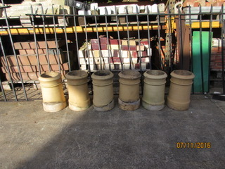 Set of six buff chimney pots. Each one cost