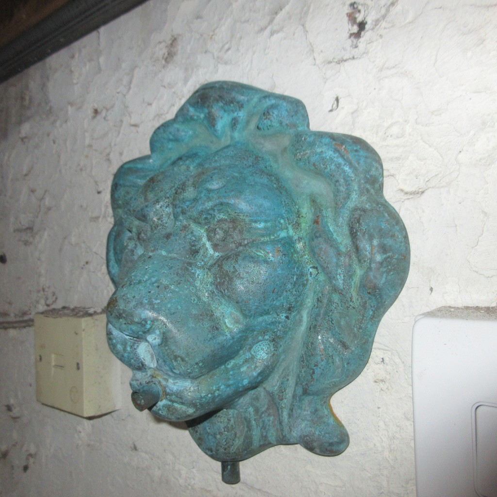 Bronze wall fountain mask