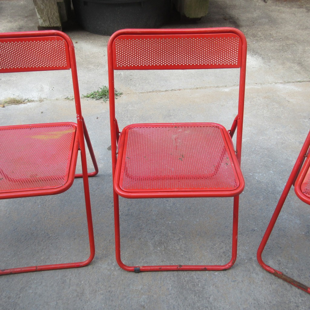 Set of 4 folding metal chairs